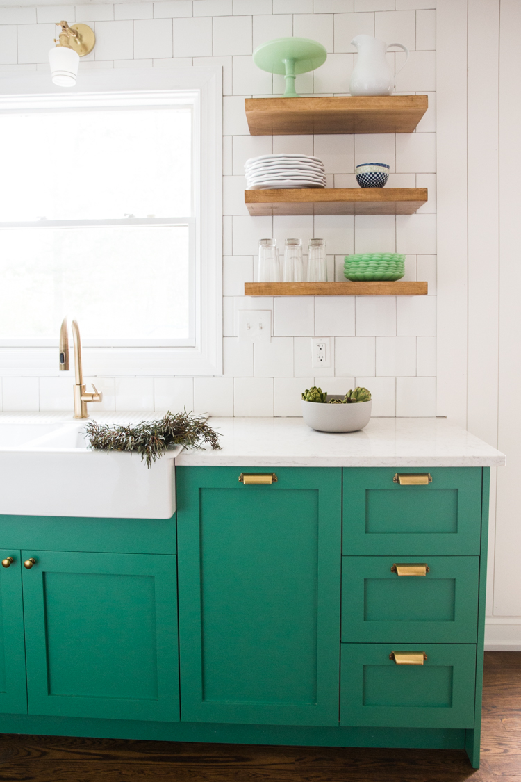Bold, Small Kitchen with Green Cabinets and Slate Appliances